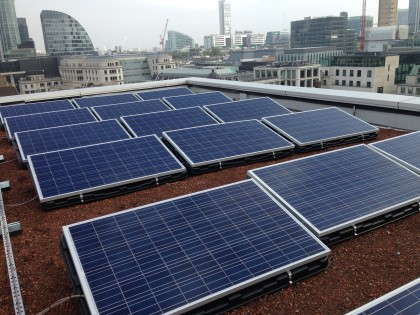 Solar PV panels on ballasted Flat roof mounting system Central London